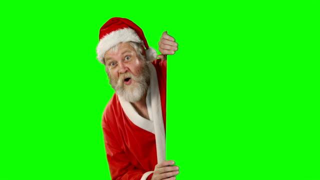 Ãœberrascht-Santa-Claus-winken-Hand-auf-green-screen