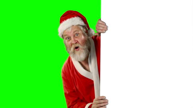 Sorprende-Papá-Noel-agitando-la-mano-en-la-pantalla-verde
