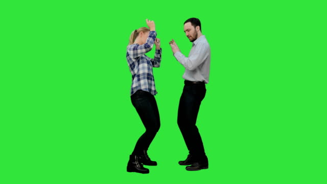Young-couple-dancing-together-on-a-Green-Screen-Chroma-Key