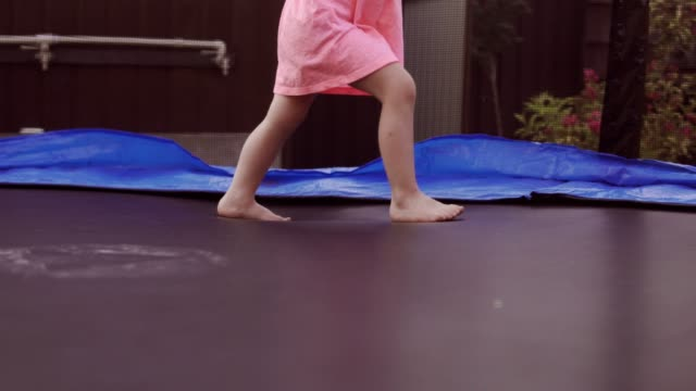 Happy-Girl-Jumping-on-Trampoline-Funny-Action-in-4k-UHD