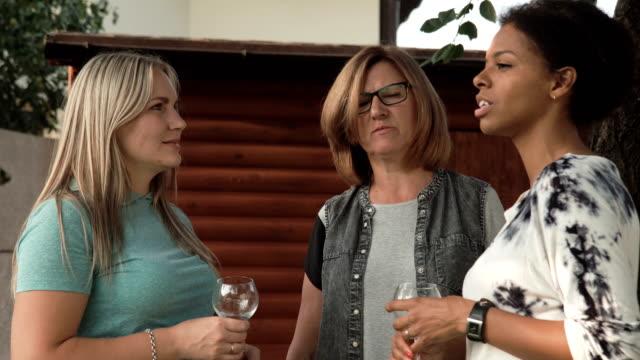 Women-talking-on-family-party