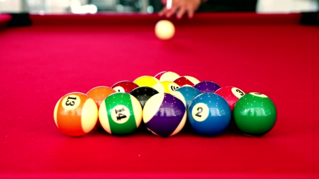 Playing-the-pool-billiard-game-on-red-baize-table-This-is-sports