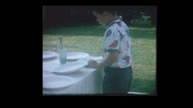 Young-boy-sets-picnic-table
