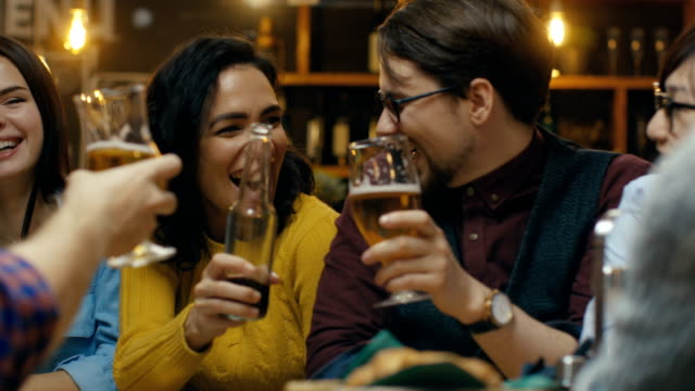 Company-of-Friends-Having-Fun-in-the-Bar-They-Drink-Talk-and-Joke-Around-Beautiful-Young-People-Have-Good-Time-