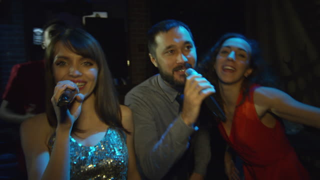 Multi-Ethnic-Friends-Partying-and-Singing