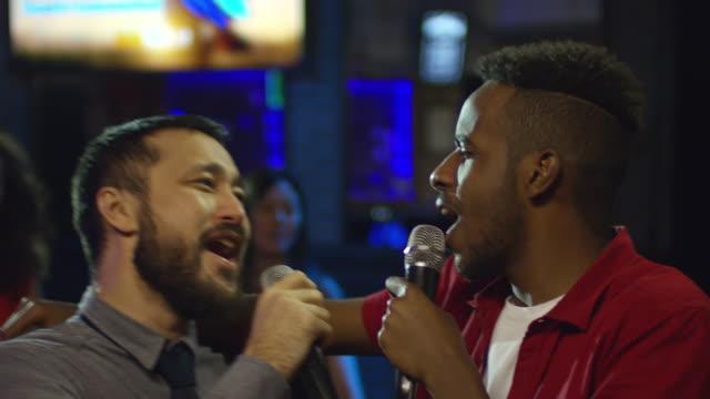 Multi-Ethnic-Friends-Singing-Karaoke