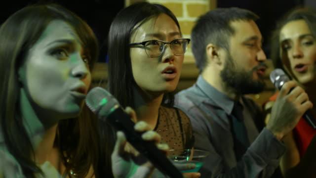 Young-People-Singing-Karaoke-in-Nightclub