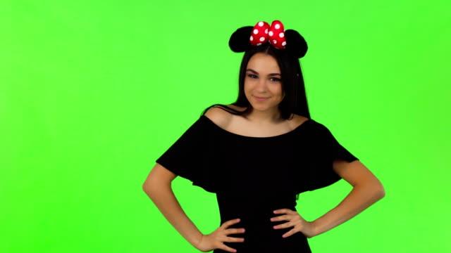 Beautiful-woman-wearing-fluffy-mouse-ears-posing-playfully