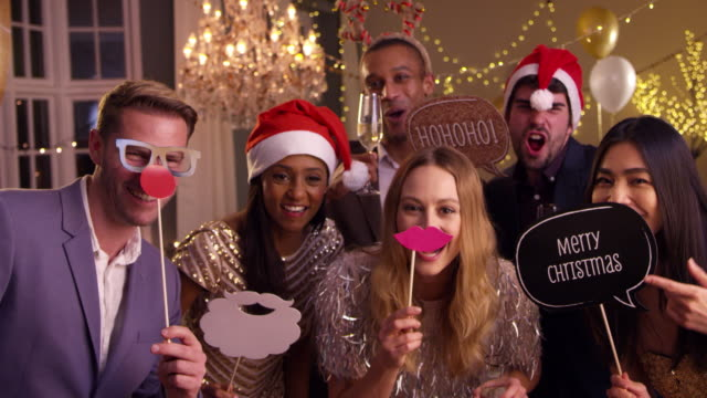 Group-Of-Friends-Dressing-Up-For-Christmas-Party-Together