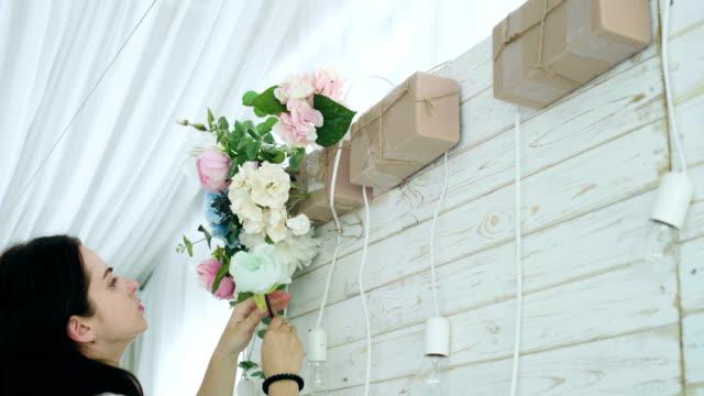 Closeup-beautiful-florist-creating-spring-colorful-bouquet-arrangement