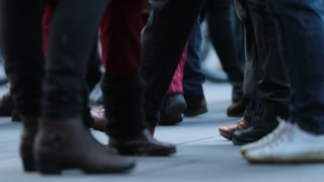 Low-angle-Legs-of-Crowd-People-Walking-on-the-Street-Close-up-of-Crowd-feet-in-4K-60fps