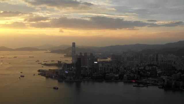 4-k-hyperlapse-aérea-escena-de-ciudad-de-Hong-Kong-con-escena-de-Victoria-bahía-en-puesta-del-sol
