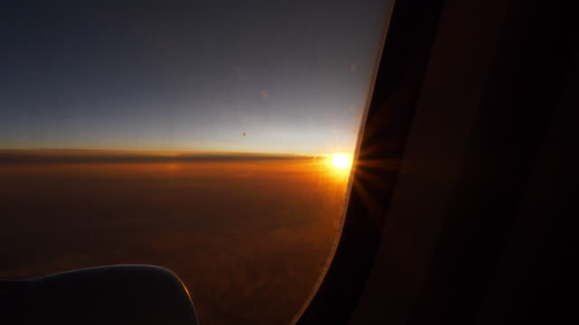 sunset-sun-light-airplane-window-seat-view-4k-china