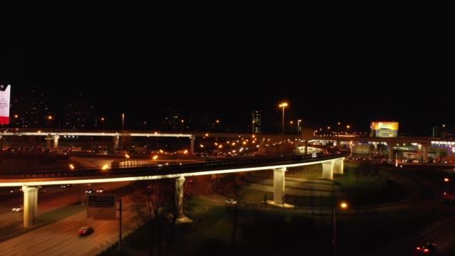 Aerial-Transport-road-junction-Modern-city-traffic-road-at-night-Transport-road-junction-