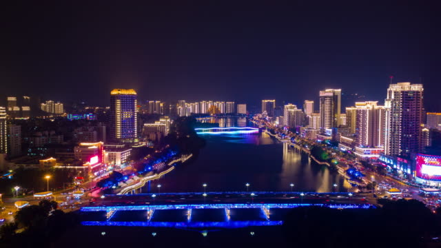 nachts-beleuchtet-Sanya-Stadt-Fluss-aerial-Panorama-Zeitraffer-4k-china