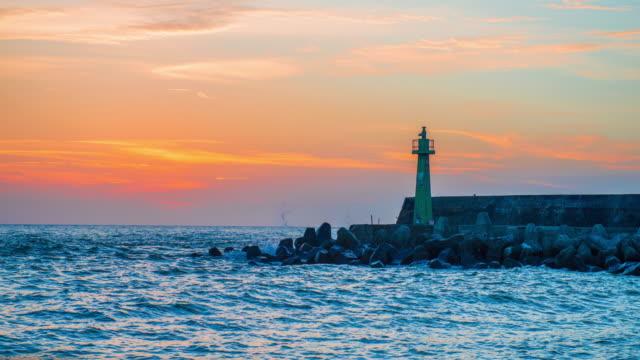 lighthouse-under-sunburst