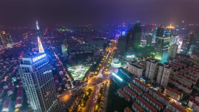 china-night-illumination-shanghai-city-road-junction-cityscape-aerial-panorama-4k-time-lapse