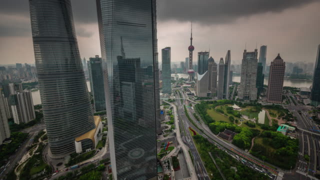 china-shanghai-city-downtown-storm-sky-roof-top-traffic-road-panorama-4k-time-lapse