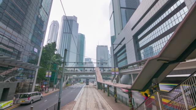 camino-del-tranvía-ligero-de-día-viaje-de-lapso-de-tiempo-de-4-k-de-ciudad-de-hong-kong