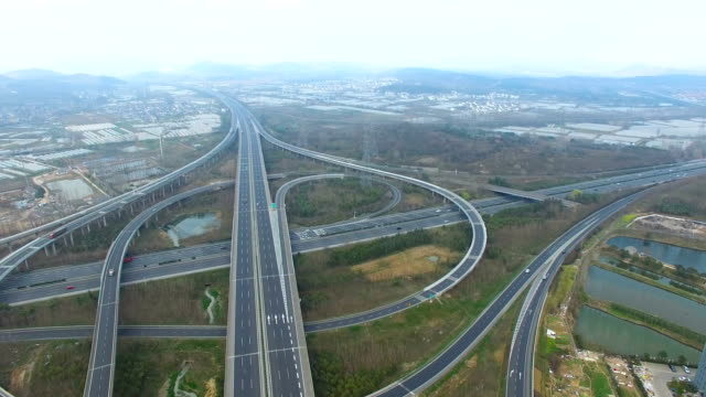 Aerial-view-of-traffic-on-elevated-freeway-at-intersection-city-suburbs-china