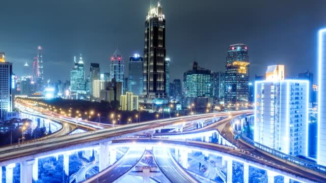 aerial-view-of-traffic-on-freeway-interchange-at-night-4K-UHD-timelapse