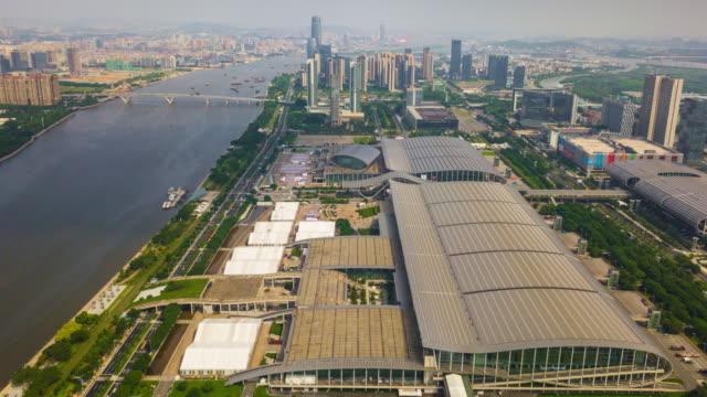 China-día-soleado-guangzhou-ciudad-famosa-Convención-y-exposición-centro-panorama-aéreo-4k-timelapse