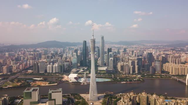 China-día-soleado-guangzhou-ciudad-centro-río-Perla-Cantón-torre-panorama-aéreo-4k-timelapse