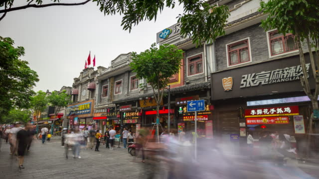 wuhan-city-pedestrian-crowded-street-day-time-old-buildings-front-panorama-4k-time-lapse-china