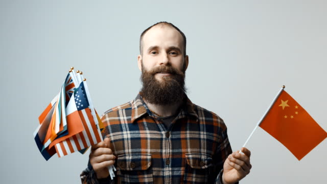 Man-holding-national-flags
