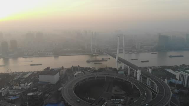 Nanpu-Bridge-over-Huangpu-River-in-Dawn-Shanghai-China