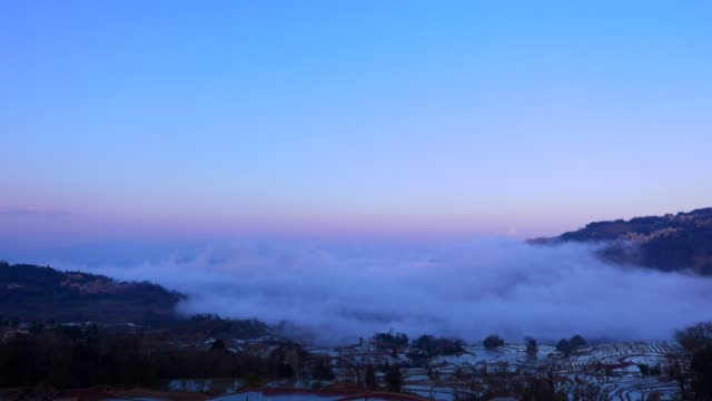 Time-lapse-of-dynamic-sea-of-clouds-in-mountainous-rice-terrace-landscape