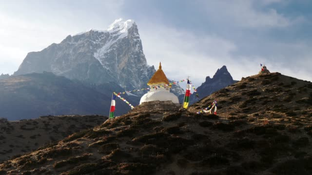 Steadicam-shot-of-stupa-with-prayer-flags-on-track-to-the-base-camp-of-Everest-in-the-Himalayas-Nepal