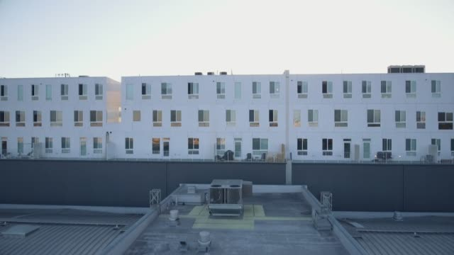 Vista-aérea-de-los-edificios-en-el-centro-de-la-ciudad-de-Los-Ángeles-durante-la-puesta-de-sol
