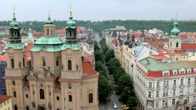 top-view-of-Church-of-Saint-Nicholas-and-picturesque-street-in-Prague-from-Old-clock-tower