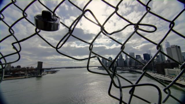 A-Scene-with-the-View-of-New-York-Waterfront-Thru-a-Bridge-Fence-