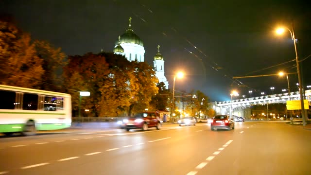 driving-car-in-night-moscow-past-Cathedral-of-the-Redeemer