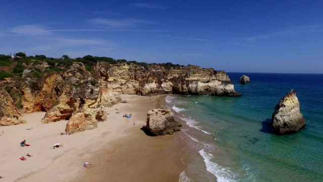 Aerial-from-natural-rocks-at-Praia-Tres-Irmaos-in-Alvor-Portugal