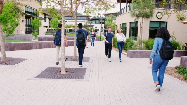 High-School-Students-Socializing-Outside-College-Buildings
