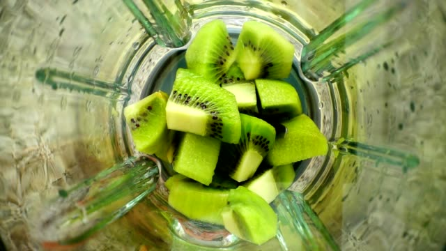 Crushing-of-a-kiwi-in-the-blender-Slow-motion-Preparation-of-smoothie-in-the-blender-