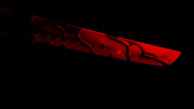 Schwert-tropft-Blut-im-Rotlicht