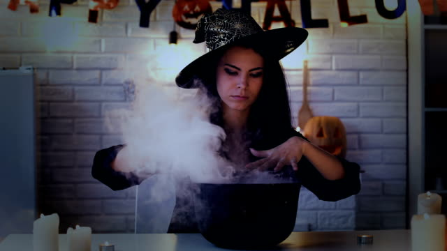 Mysterious-young-woman-in-witch-costume-cooking-potion-preparing-for-Halloween