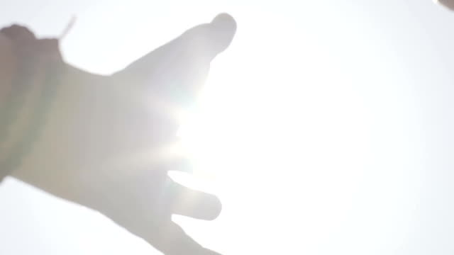 Search-of-God-concept-hands-reaching-up-to-sun-asking-help-divine-bright-light