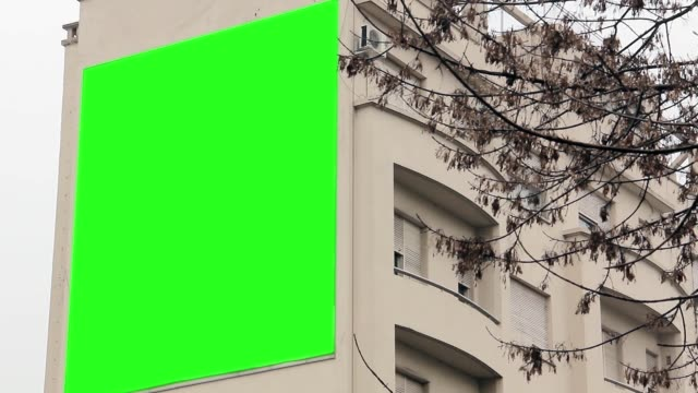 Billboard-with-Green-Screen-on-a-Building-
