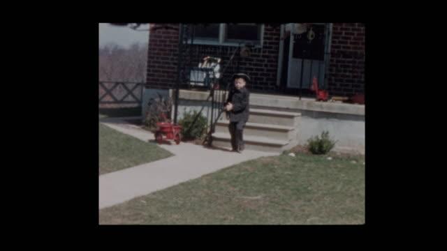 1956-Little-boy-wearing-Tricorne-hat-gets-into-vintage-antique-car