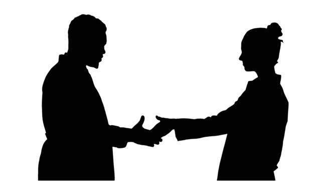 Silhouette-zwei-junger-Arzt-Hände-schütteln