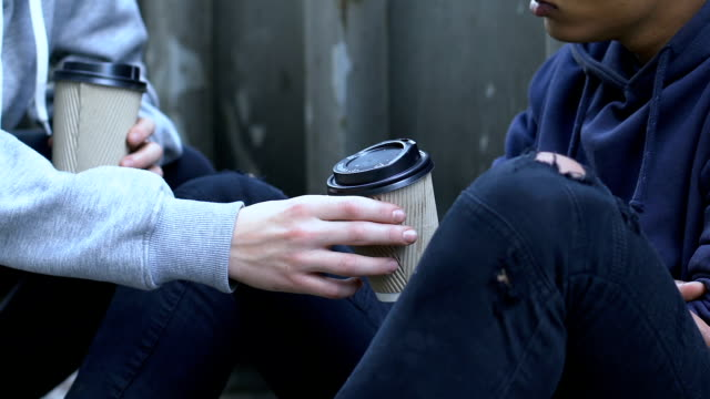 Friendly-boy-sharing-coffee-with-frozen-homeless-child-human-help-compassion