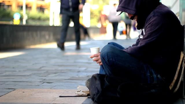 Homeless-beggar-man-begging-on-the-street