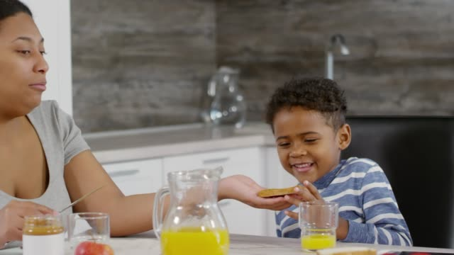 Mother-Making-Toasts-for-Children