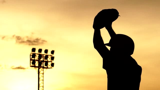 Silhouette-Baseball-athletes-are-training-hard-with-the-sunset
