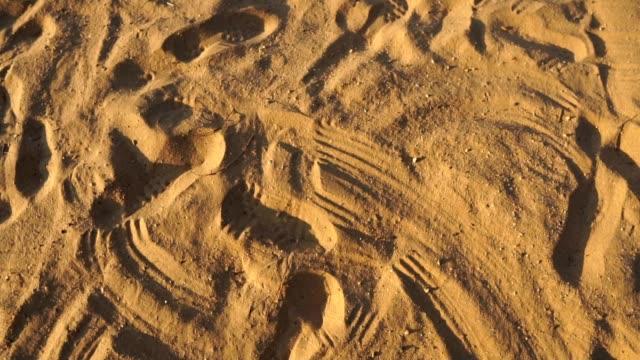 Men-s-baseball-players-were-sliding-on-the-sandy-pitch